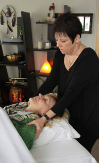 Jackie Cooper doing Healing Touch on a client